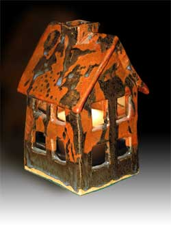 light into any room. A chimney vent relieves any heat from the candle